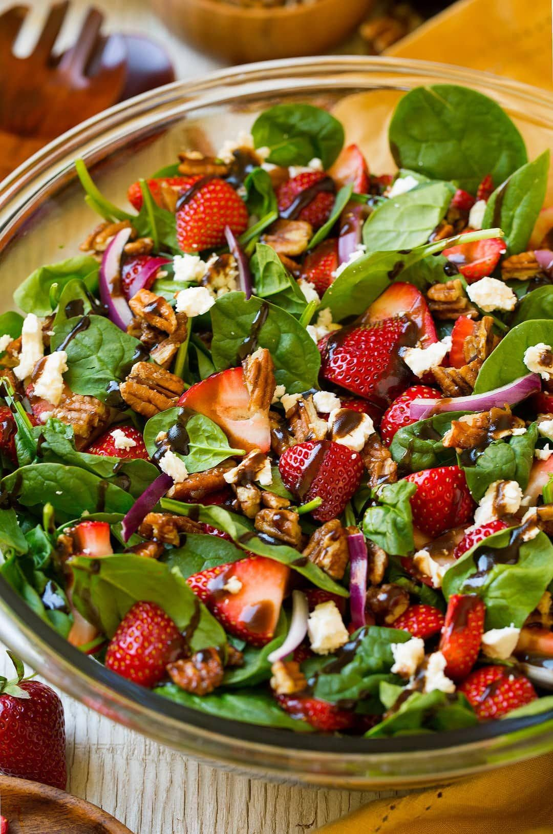 Strawberry Spinach Salad. An easy and delicious spinach salad made with strawberries, feta, candied pecans and a balsamic vinaigrette. | Strawberry Salad | Summer Salads | Easy Salads |