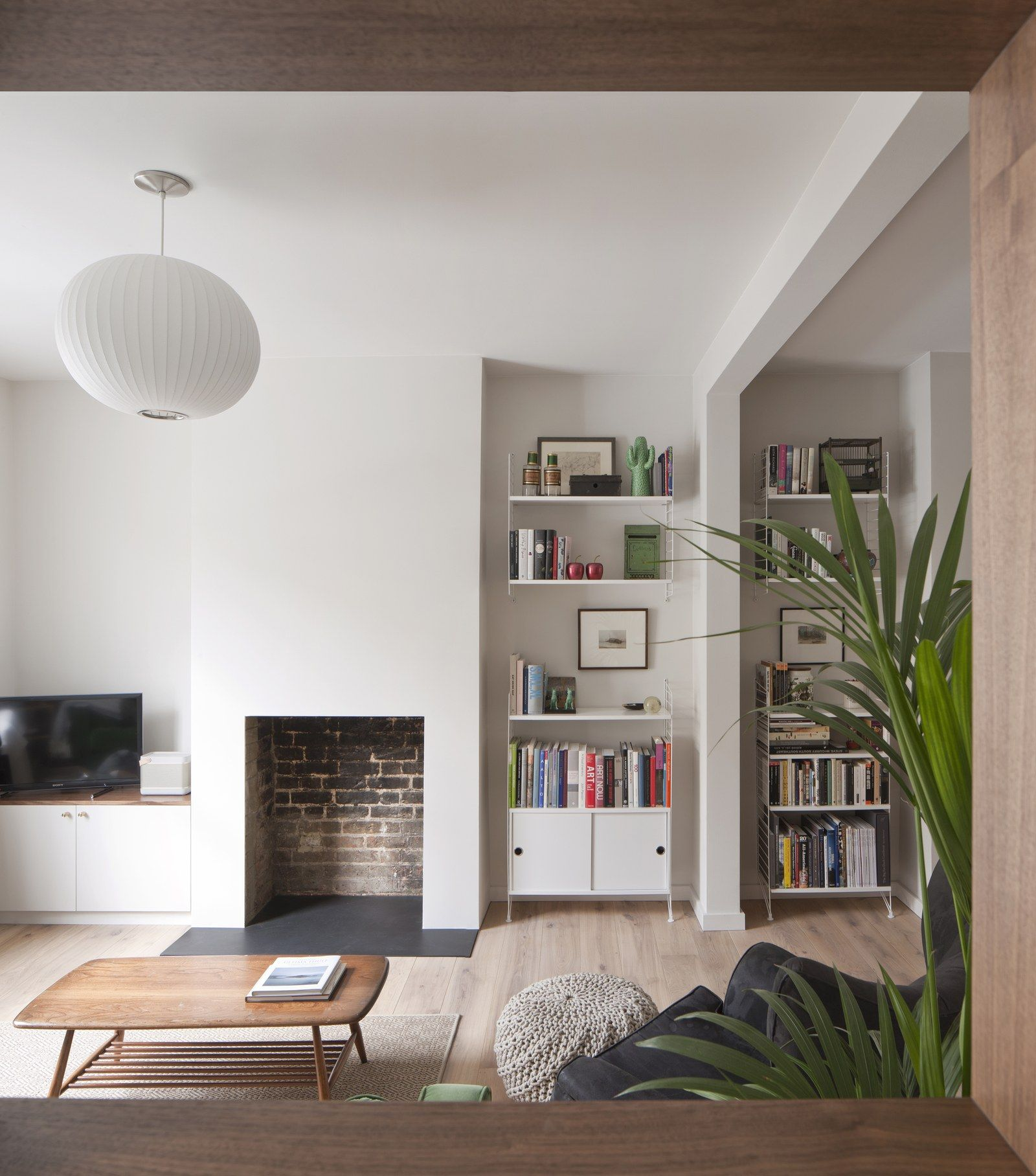 See How A Tiny Extension Turned This London Rowhouse Into A Dream Home Living Room With Fireplace White Living Room Minimalist Living Room #row #home #living #room #ideas