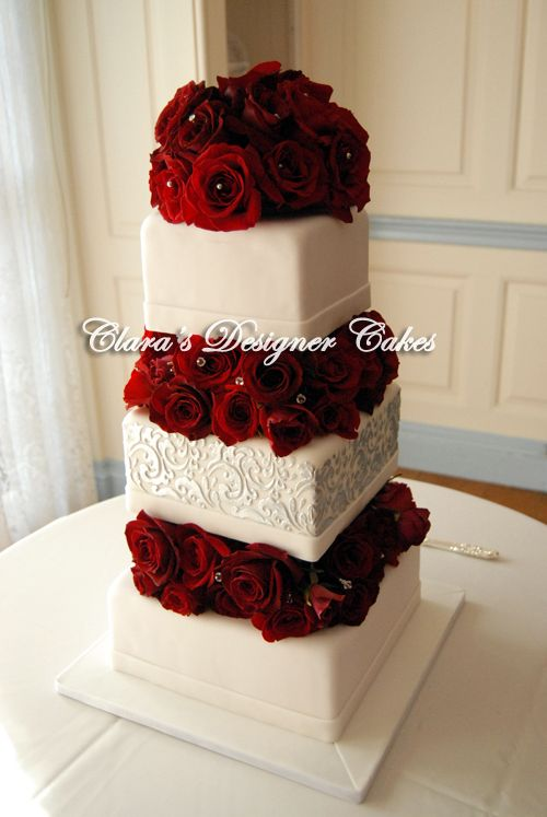 Wedding Cake Art And Design Center : Red roses and gems adorn this elegant wedding cake. The ...
