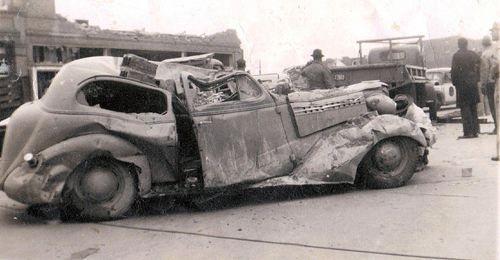 Men and car in Main Street after the tornado Higgins TX tornado 4/9/1947