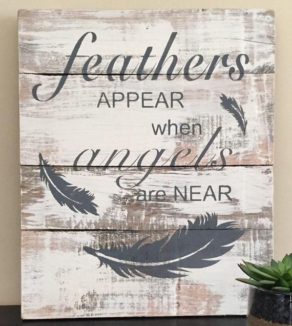 This rustic feather sign is hand made/hand painted with ...