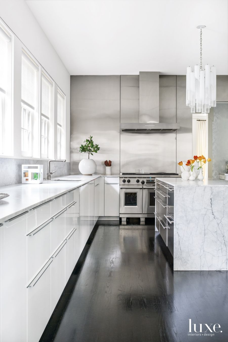 High Polish White Poggenpohl Cabinetry With Appliances From K Amp N Sales Carrara Marble Countertops By T White Modern Kitchen Modern Black Kitchen Oak Floors