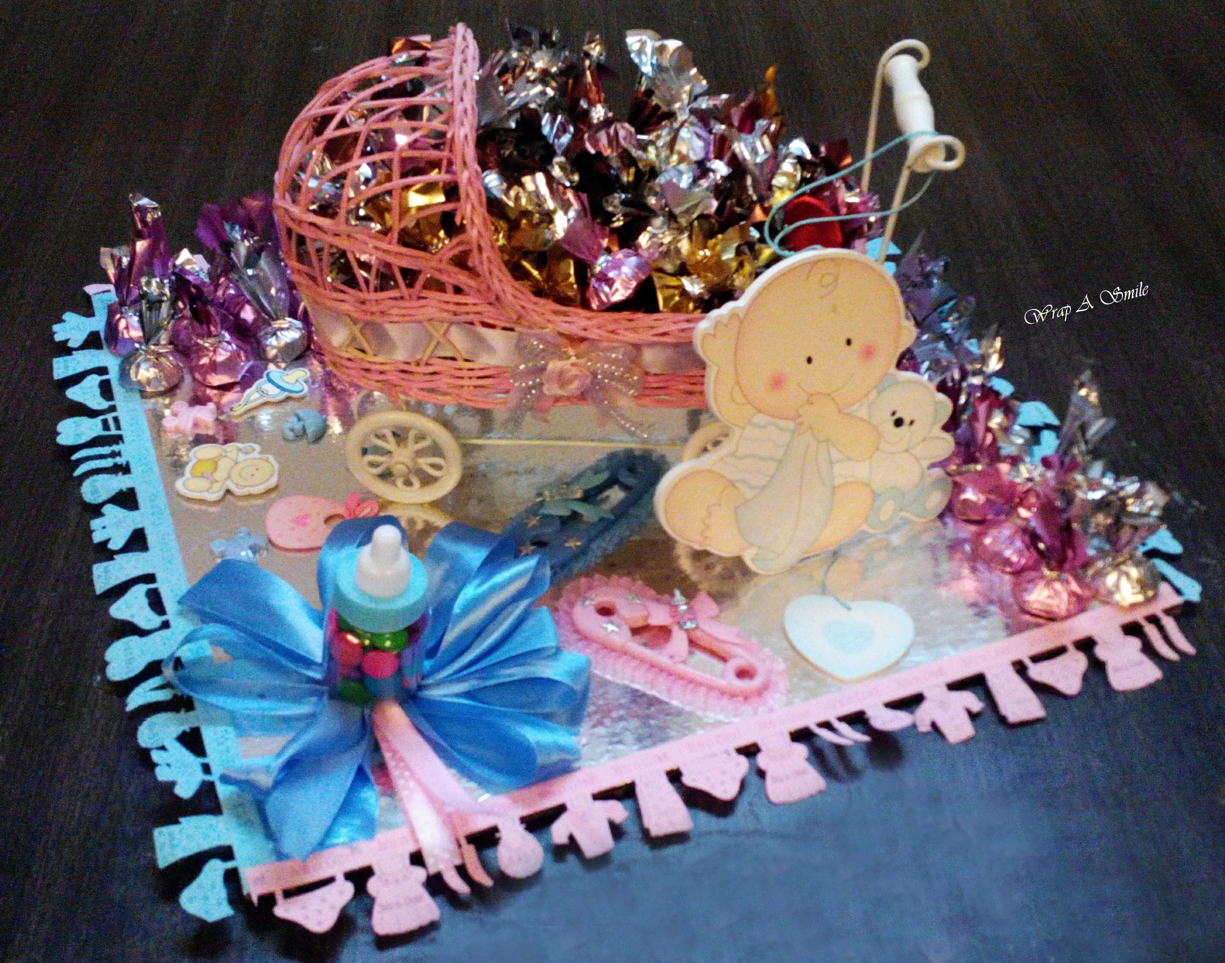 Cute bbay pram platter with chocolates for a baby shower for Baby tray decoration