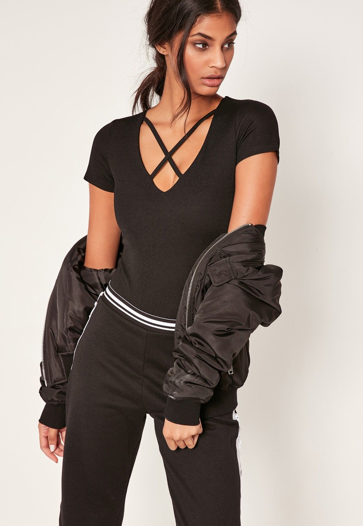 65bd123a606 ... women's tops. Missguided - Black Harness Neck Short Sleeve Bodysuit