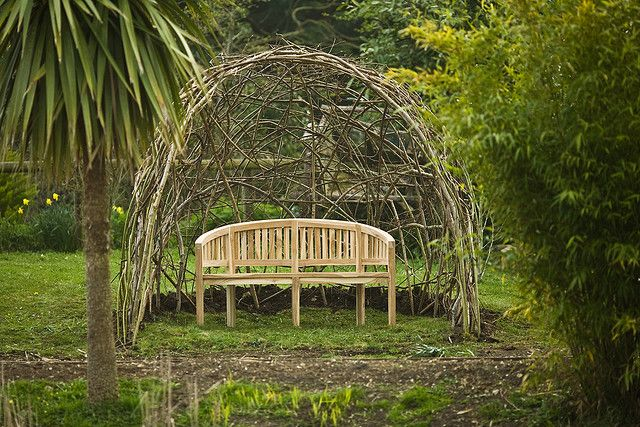 """Basket Dome and Bench. Tim Johnson, artist: """"Living Willow Seat Shelter,"""" Dorset."""