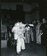 Sally Butterfly dancing the jitterbug with a serviceman at the Hollywood Canteen