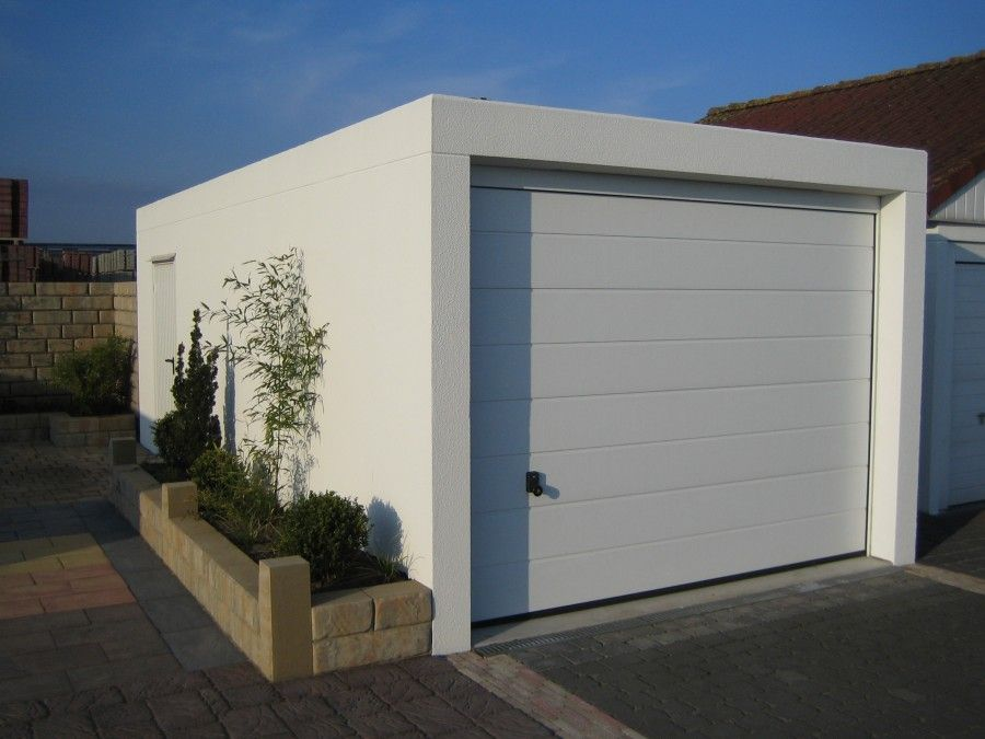 Small white exterior design of prefab garages with flat for Prefab roof