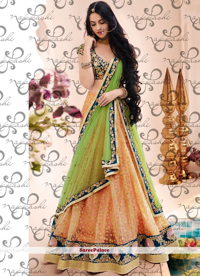 c3ef455b4b Engrossing Net Green and Peach Lehenga Choli in 2019 | Indian dress ...