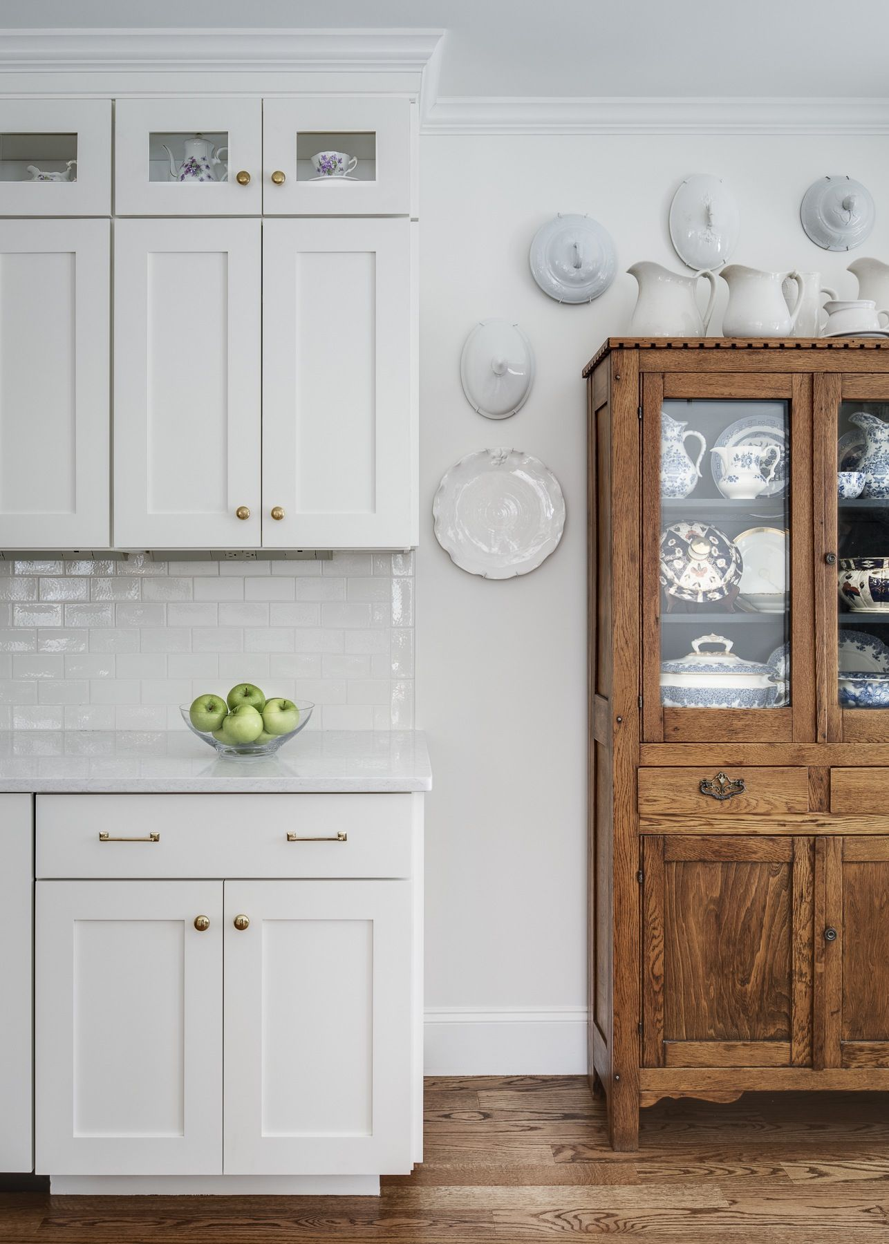 Love my antique oak cabinet against the white wall. Paint color ...