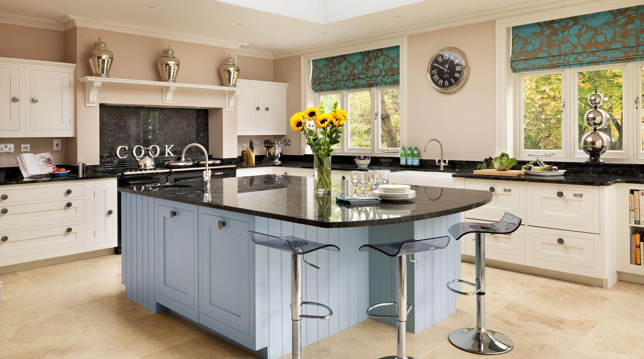 An open plan family Shaker kitchen by Harvey Jones featuring a