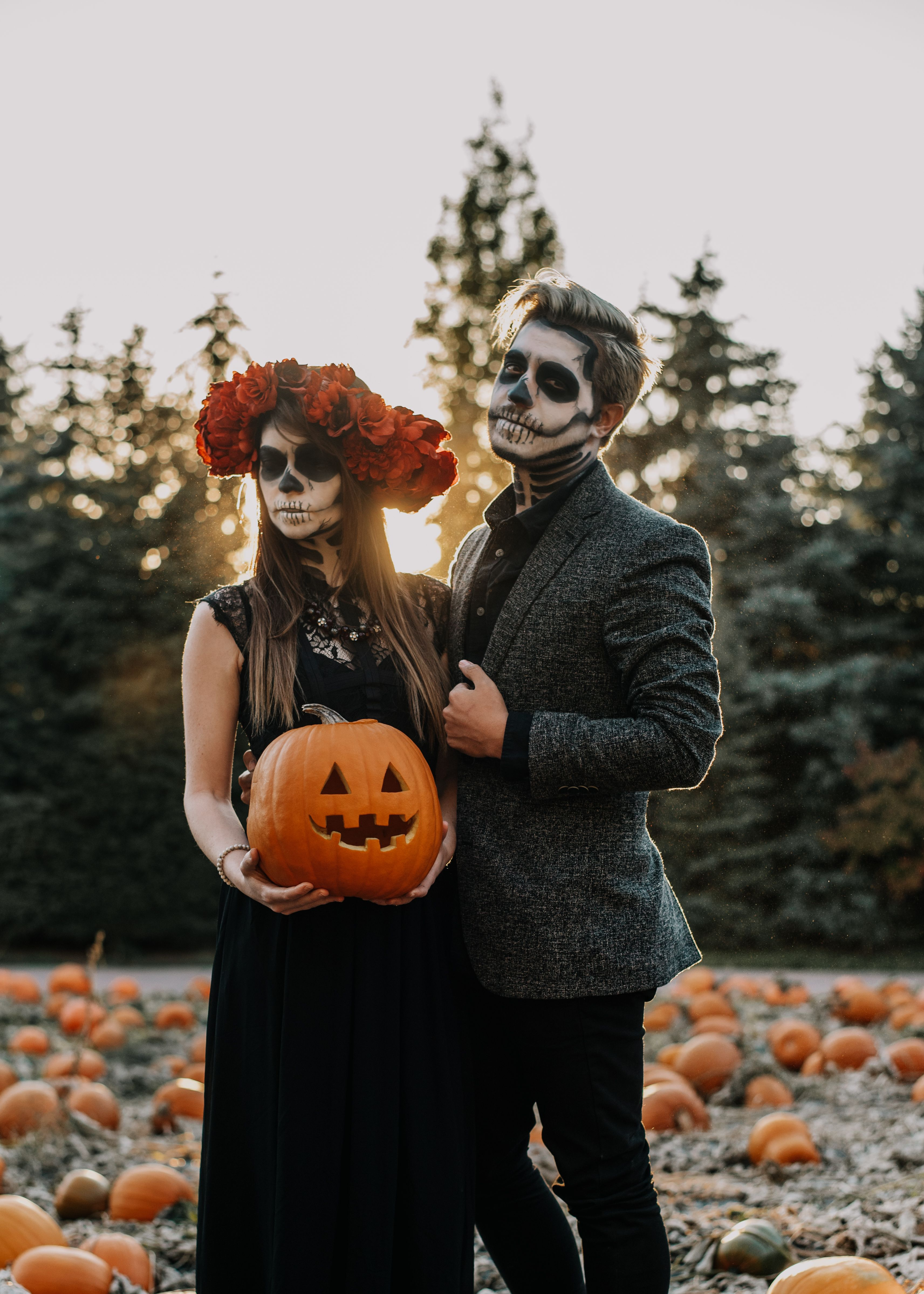 Skeleton Couple's shoot with smoke bombs, pumpkins, and
