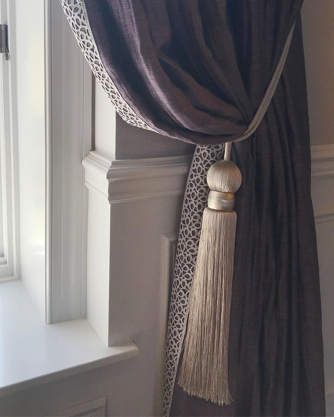 Lush Gold Filigree Braid Sets Off The Edge Of A Plum Curtain With