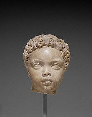 "150-200 AD Roman marble portrait head of a young boy; 8 11/16"" x 8"" x 7 1/2""; Getty 71.AA.462"