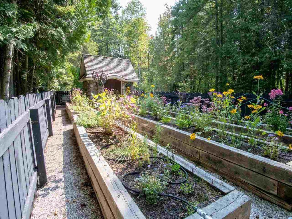 831 beach rd harbor springs mi 49740 mls 451707 zillow greenhouse veg garden for Zillow garden city mi