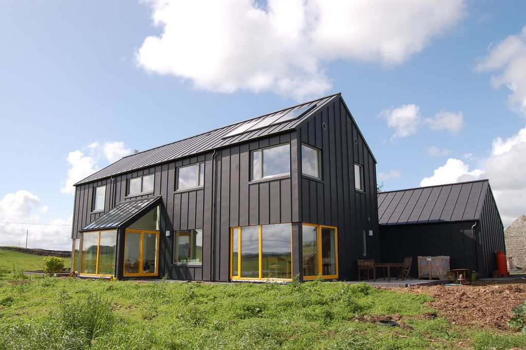 Single color house with color popping windows black zinc for Modern barn house plans
