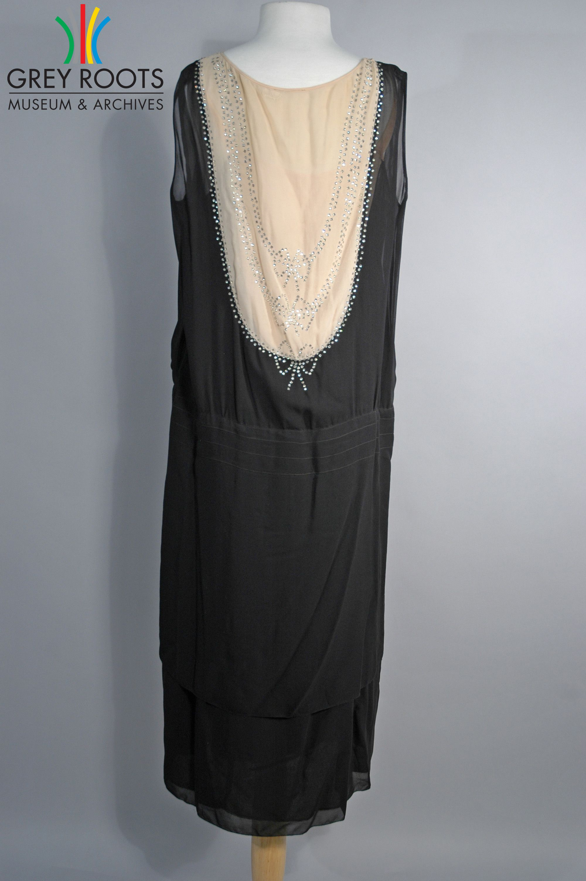 A black and beige beaded sleeveless georgette cocktail dress it