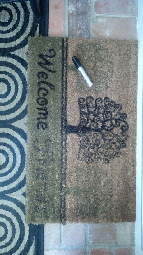 Doormat made new with black sharpie! I did the left side first just to see if it was worth it - I think so...now to finish the right side.