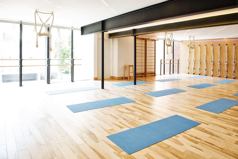 Custom designed Namastday Yoga studio featuring rope wall, dropped ...