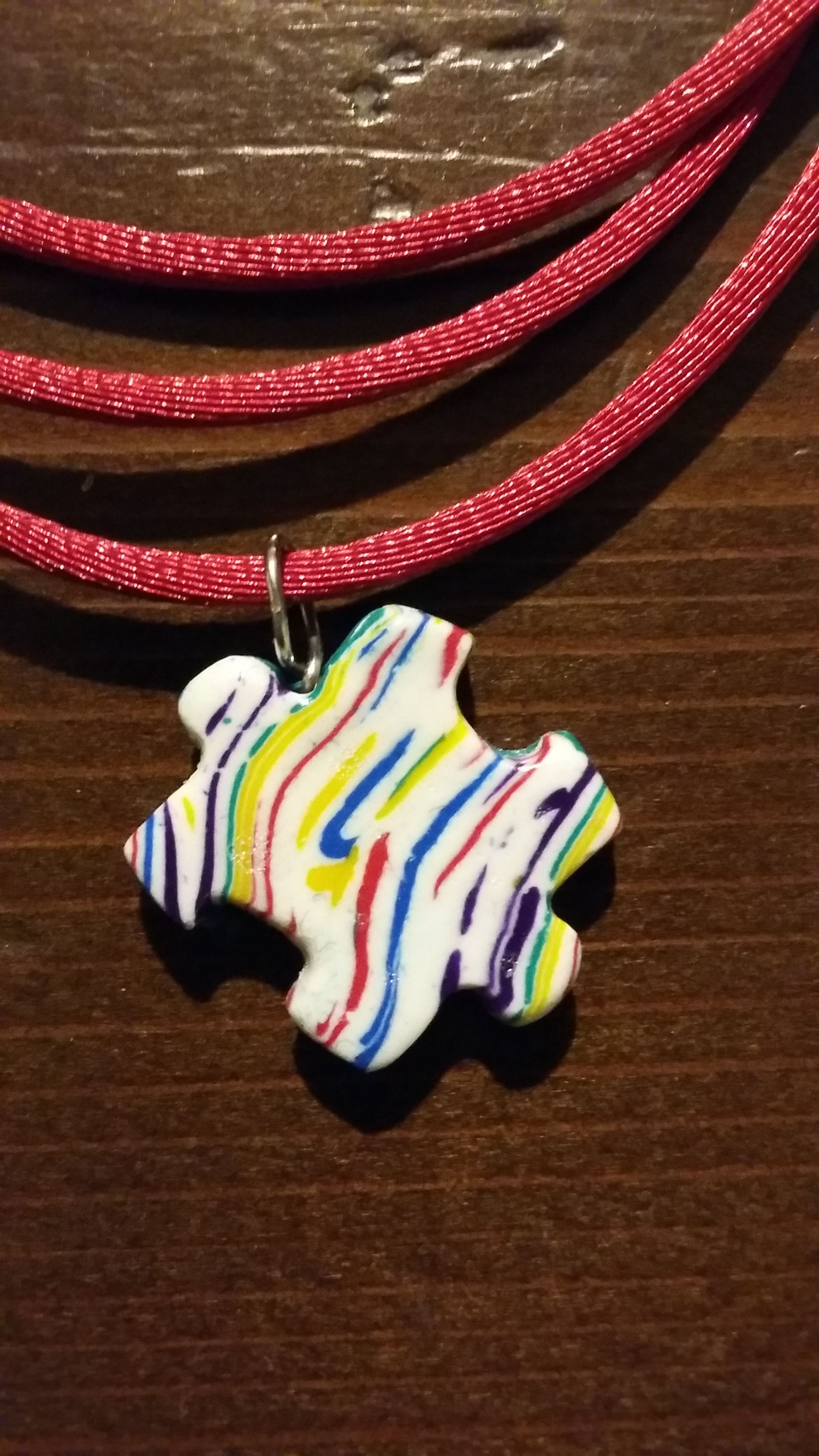 puzzle piece necklace made with polymer clay
