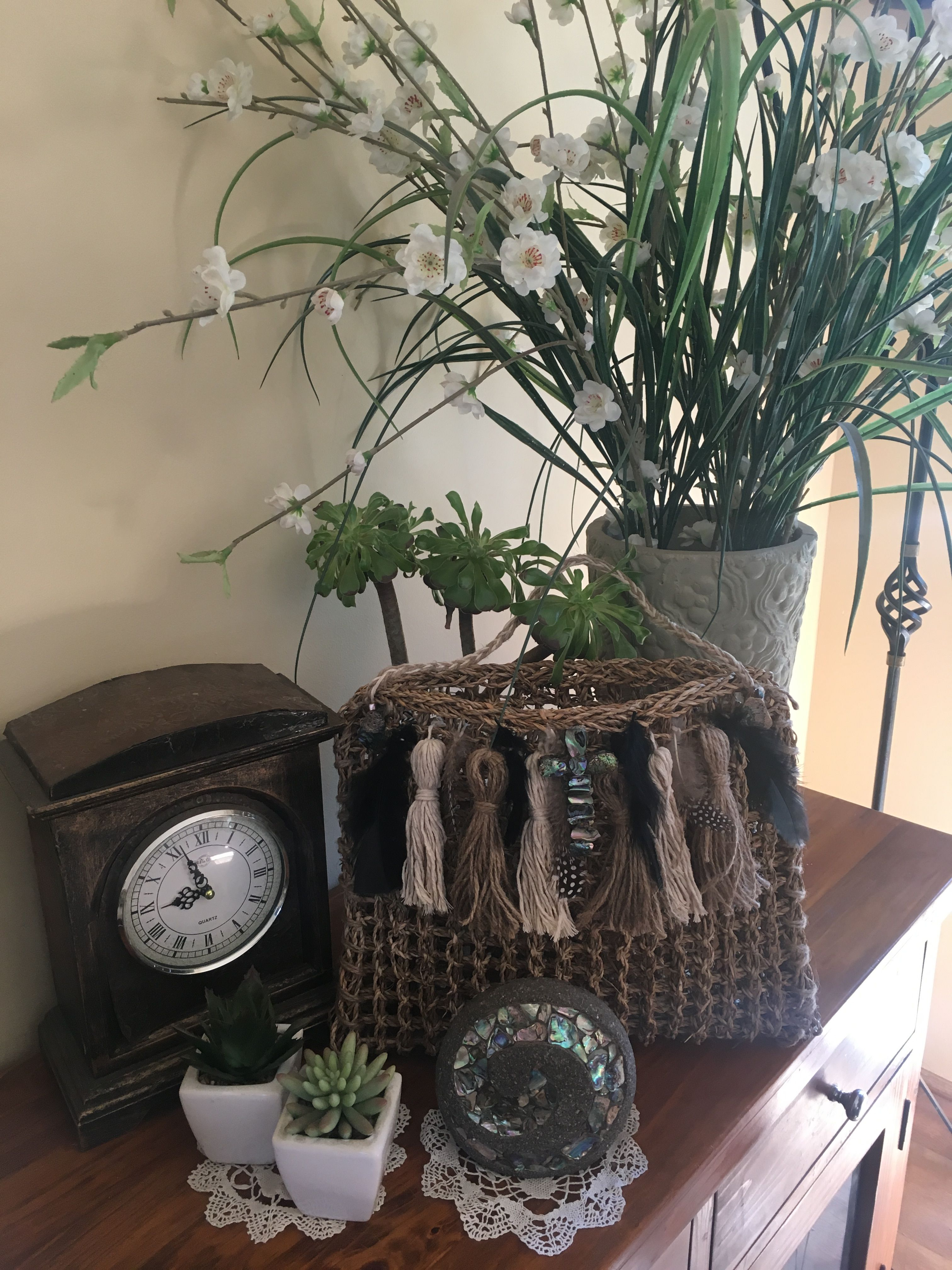 Diy bag/pot plant holder made from a mat. Plant holders