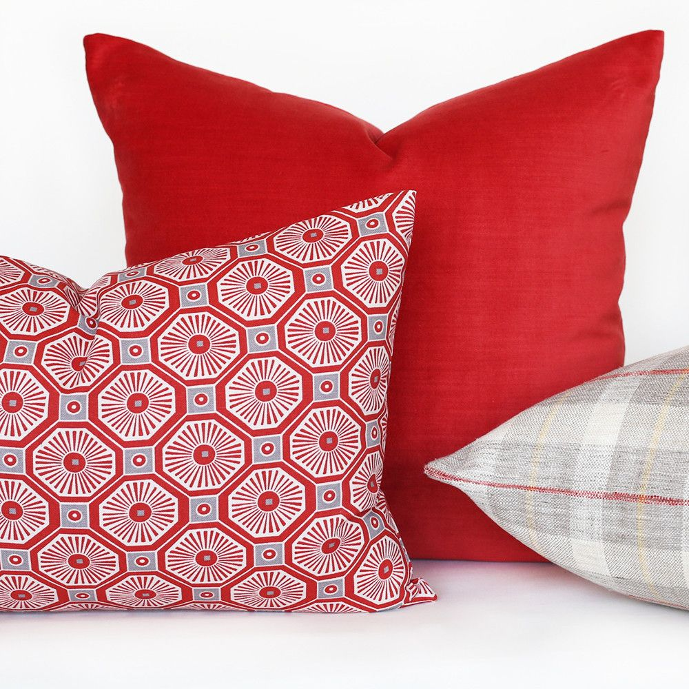 A poppy coral red velvet pillow perfect for adding an element of