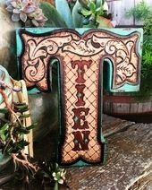 leather home decor by ArteVae Tooled leather home decor by ArteVae  Peter Pan in Bloomsbury Heres one of two book benches representing JM Barries Peter Pan character This...