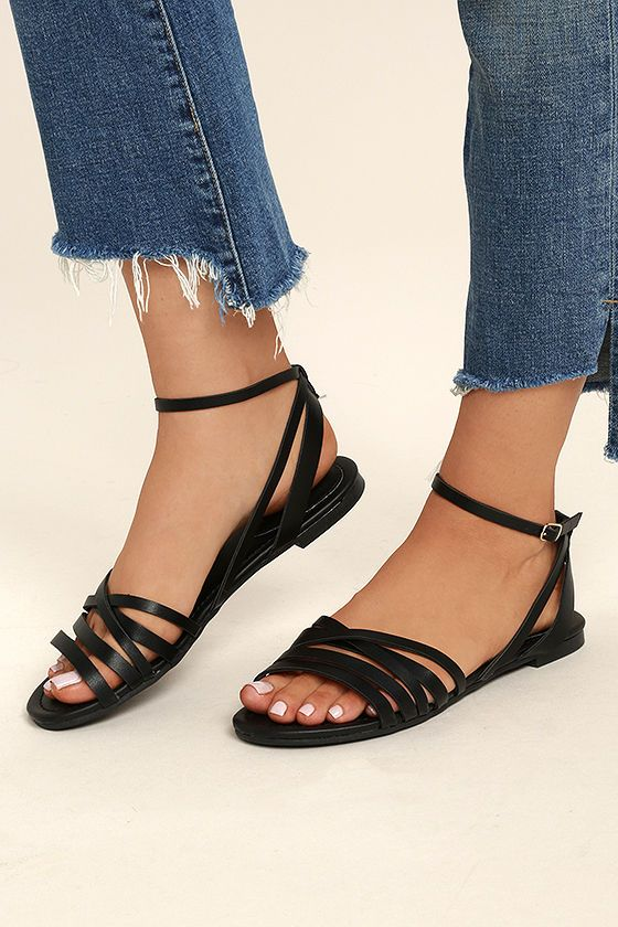 059abf02d5284 Your first steps in the Zoila Black Ankle Flat Sandals should be straight  toward the sun and sand! Vegan leather straps cross over a peep-toe upper