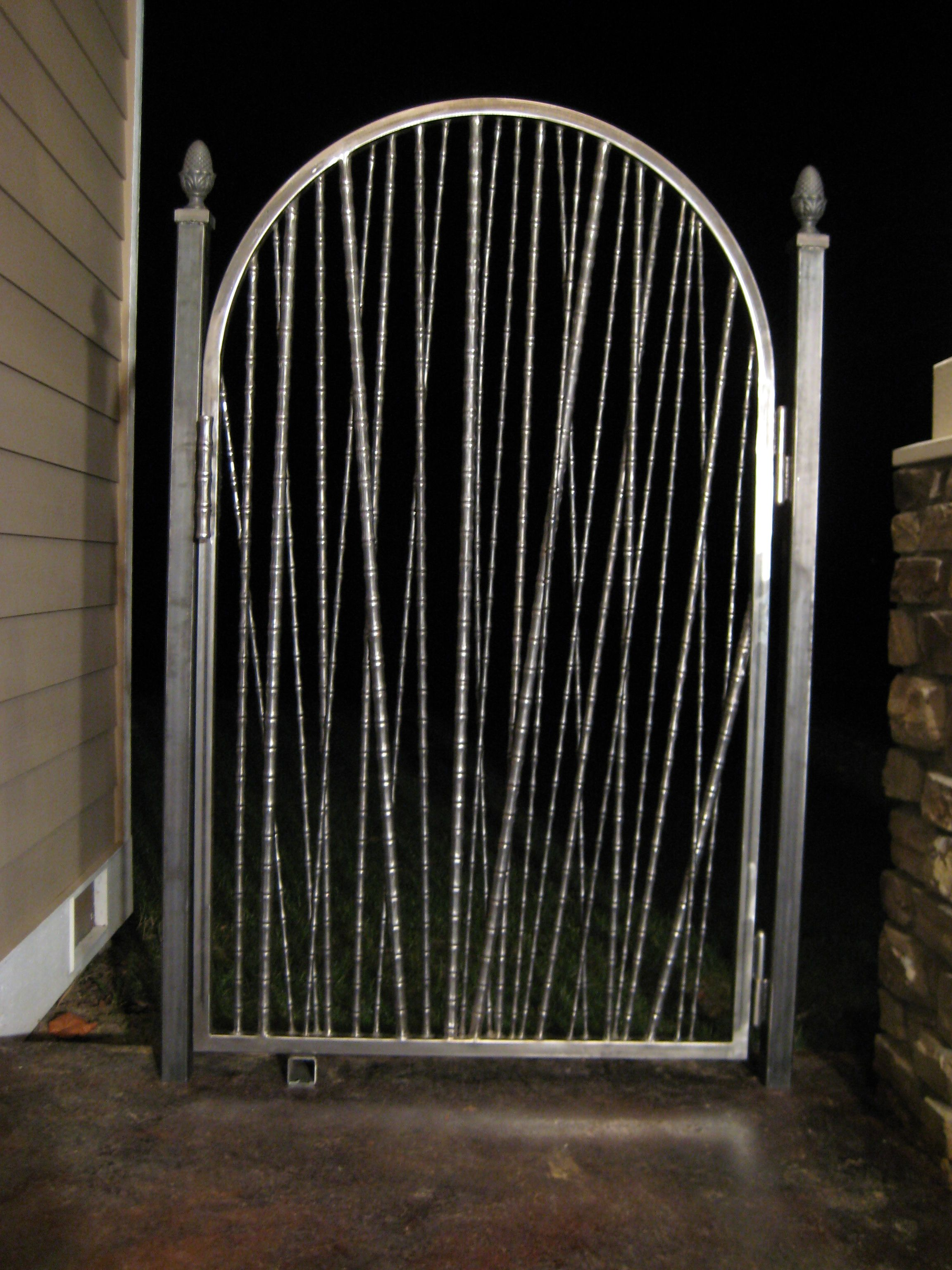 Bamboo Gate A Really Popular Design This Wrought Iron Gate Uses Different Gauge Bamboo Pieces For A Totally Entrance Gates Design Gate Design Entrance Gates