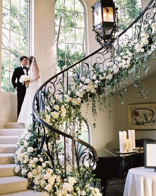 Holy floral staircase! We feel like we've stepped into an enchanting dream thanks to this #wedding! | Photography: @josevilla | Cinematography: @stephenalberts | Event Design: Pacific Event Production | Event Planning: @classicweddingsandevents | Floral Design: @kathywrightandco | Wedding Dress: @moniquelhuillier