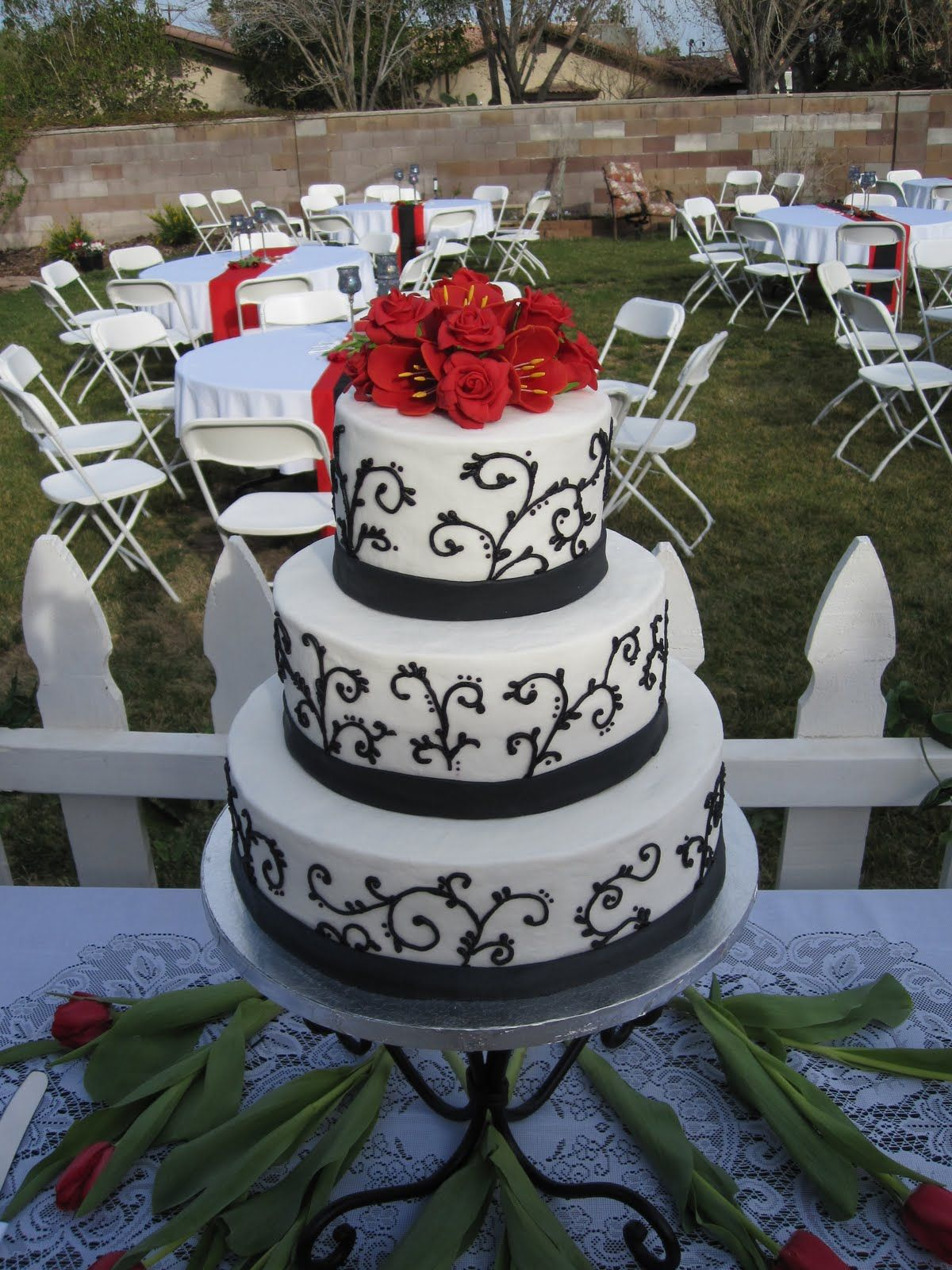 Black and White Wedding Cake with red roses and tulips. Yum ...