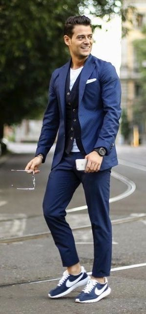 d05aed4e18 Fall business casual inspiration with a blue suit white t-shirt navy  cardigan watch sunglasses nike sneakers no show socks. model unknown.