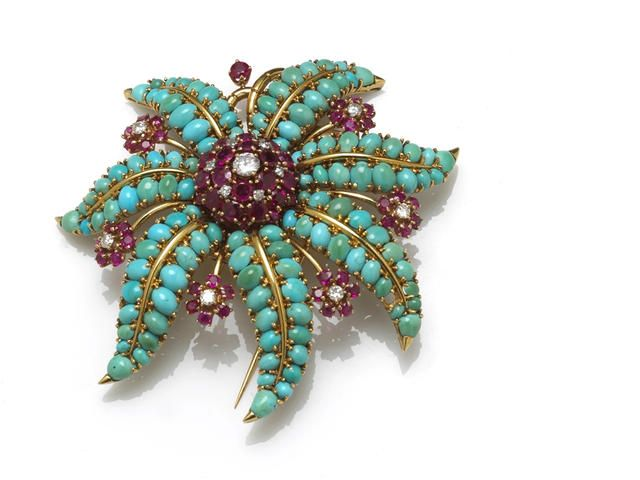A turquoise, ruby and diamond clip brooch, Rubel of floral motif; signed John Rubel Co.; mounted in eighteen karat gold; diameter: 2 1/2in. (one turquoise deficient