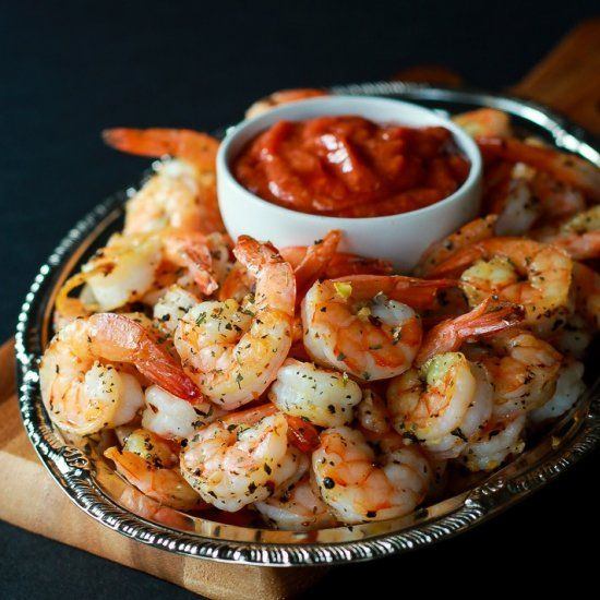 Garlic Herb infused Roasted Shrimp served with a homemade Cocktail Sauce, the ultimate Holiday Party Appetizer!