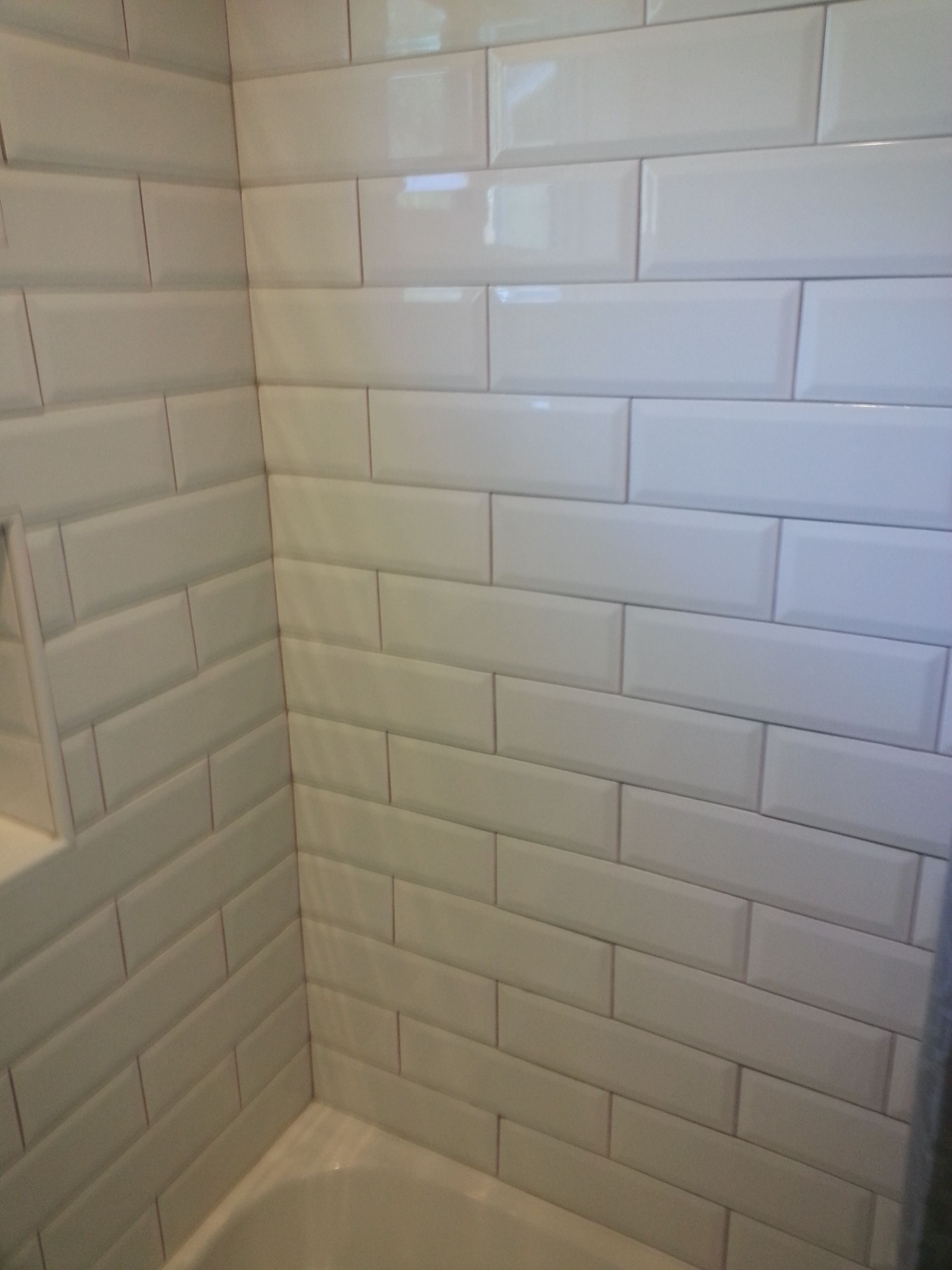 White Beveled Subway Tile With Tan Grout Ignore The Tub