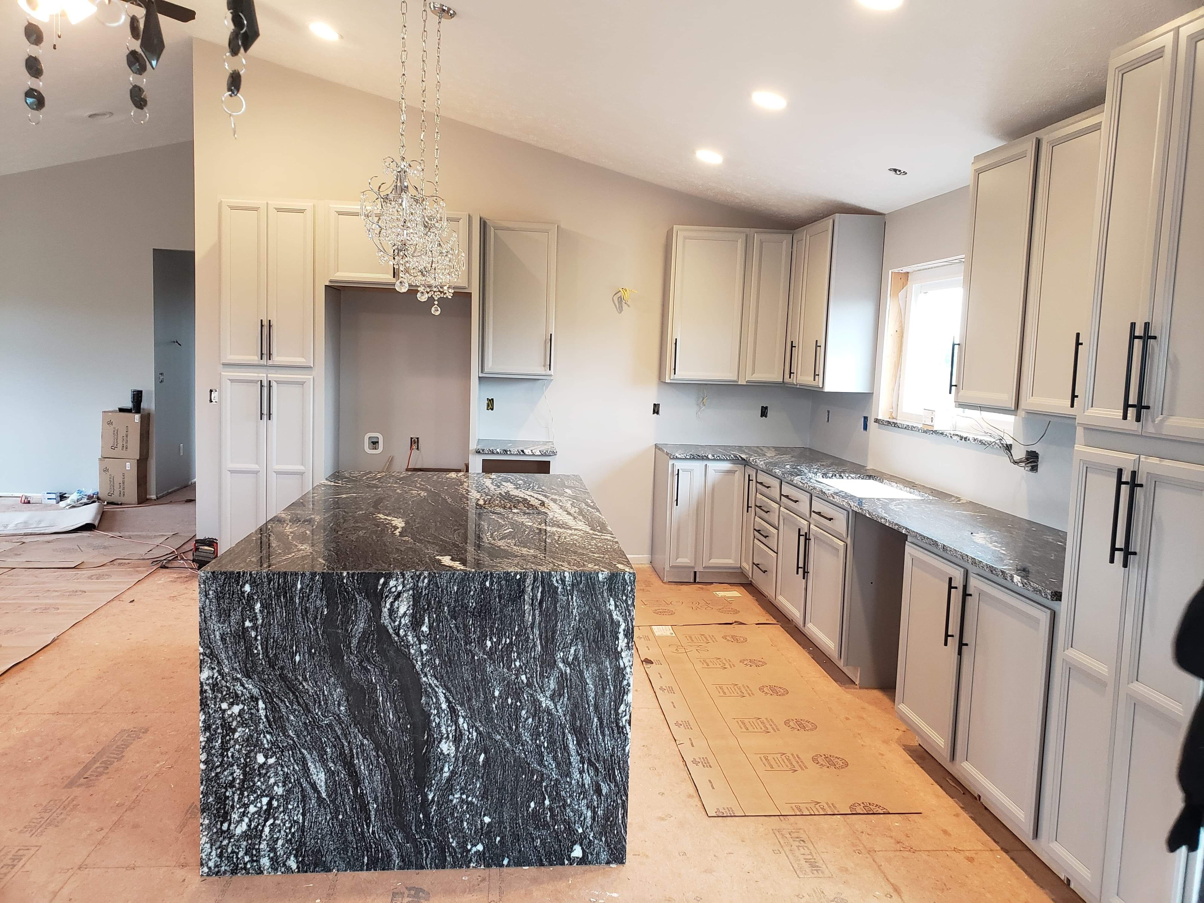 Waterfall Granite Island Countertop New Construction Black White And Gray Granite Kitchen Island Black Granite Kitchen Marble Kitchen Island
