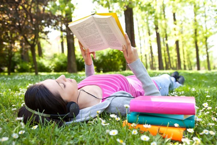 Image result for person reading in park