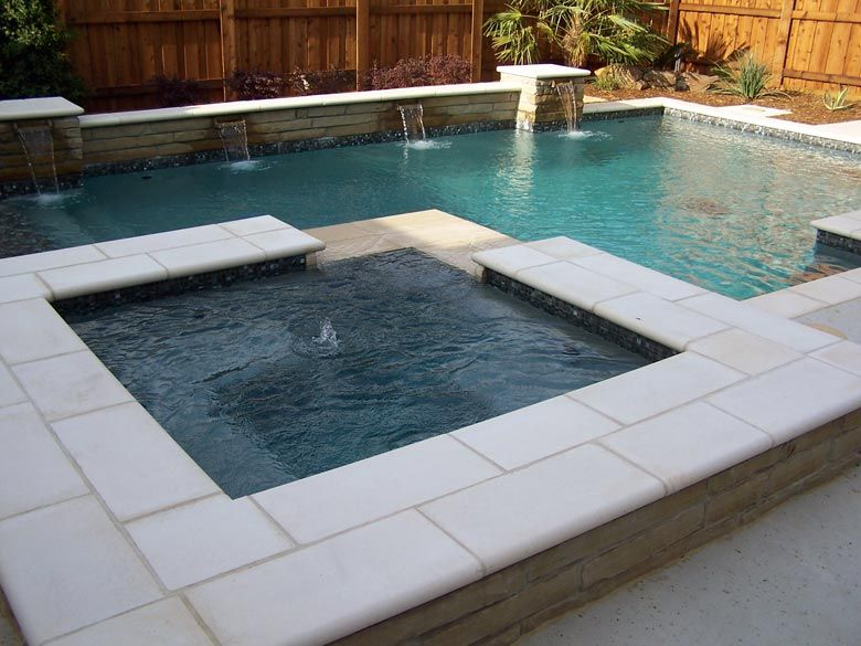 Geometric pool and spa with raised beam scuppers for In ground pool coping ideas