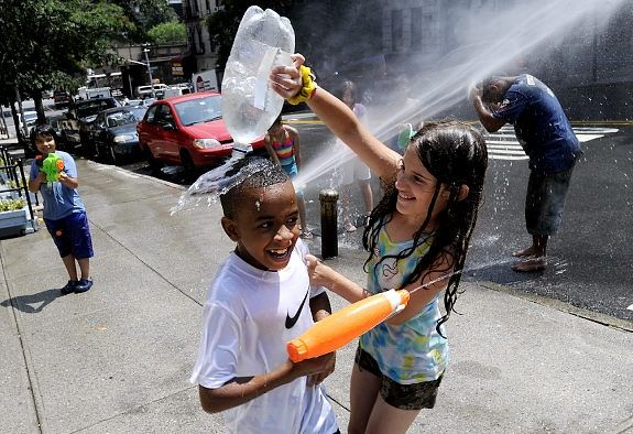 Its water fight time at LaSalle and Claremont Ave in Harlem.