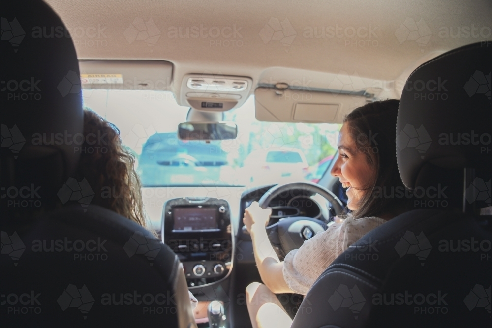 Young Adult Girls Driving And Chatting In The Car Austockphoto