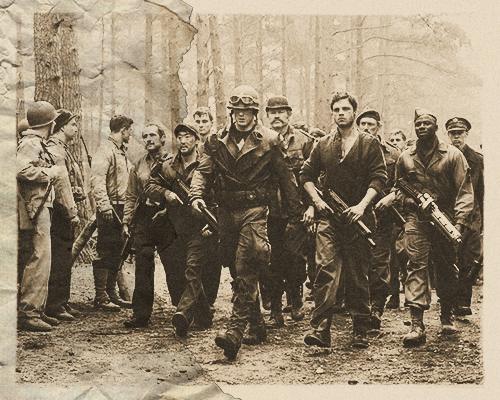 Cpt. Rogers leading a group of POWs freed from a HYDRA labor camp (Italy, November 1943).