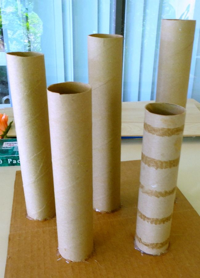 Diy tall concrete tea light candle sticks diy concrete for Diy candle crafts