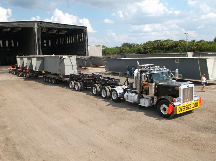 Peterbilt triaxle with two axle stinger and 3 three axle bolster axles under the load......