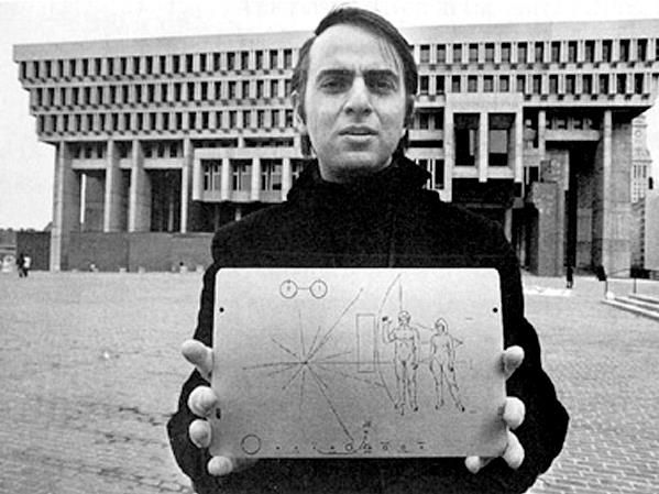 Carl Sagan holding the famous Pioneer plaque