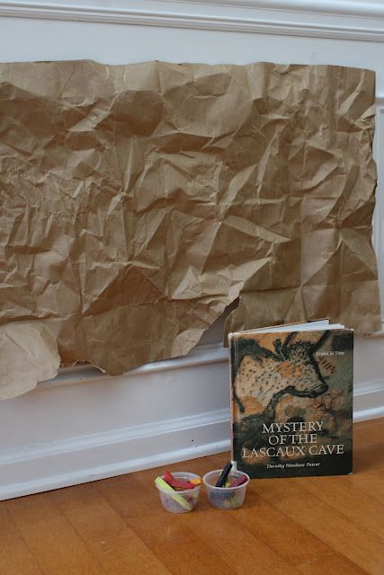 """Display idea- Crinkle brown paper, have teens do traditional """"cave paintings"""" with books incorporated."""