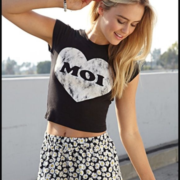 "Forever 21 black medium ""moi"" heart crop top This is a super cute cropped top with the words ""Moi"" (me in French) in it. It is from forever 21 and a size medium. it has been worn a couple of times but looks and feels brand new. no signs or wear! perfect for summer and spring. (this item is for sale on eBay.com for cheaper! just type ""seller: hazejw"" in ebays search engine. Forever 21 Tops Crop Tops"
