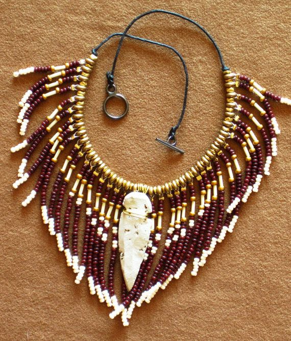 Native American style fringed beaded necklace in gold, chocolate brown and pearly white with stone arrowhead. $50.00, via Etsy.