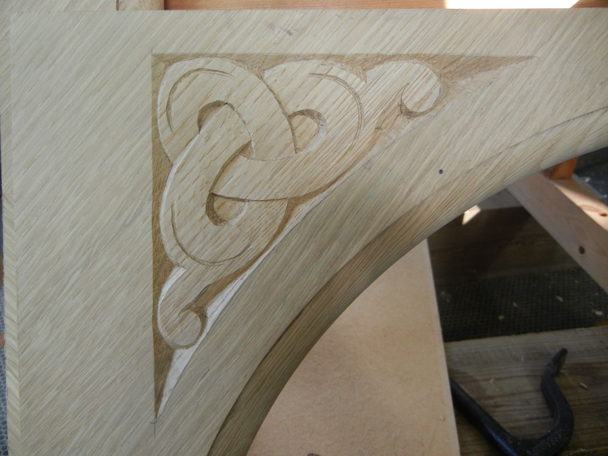 Carved celtic knot for church table in white oak celtic carving