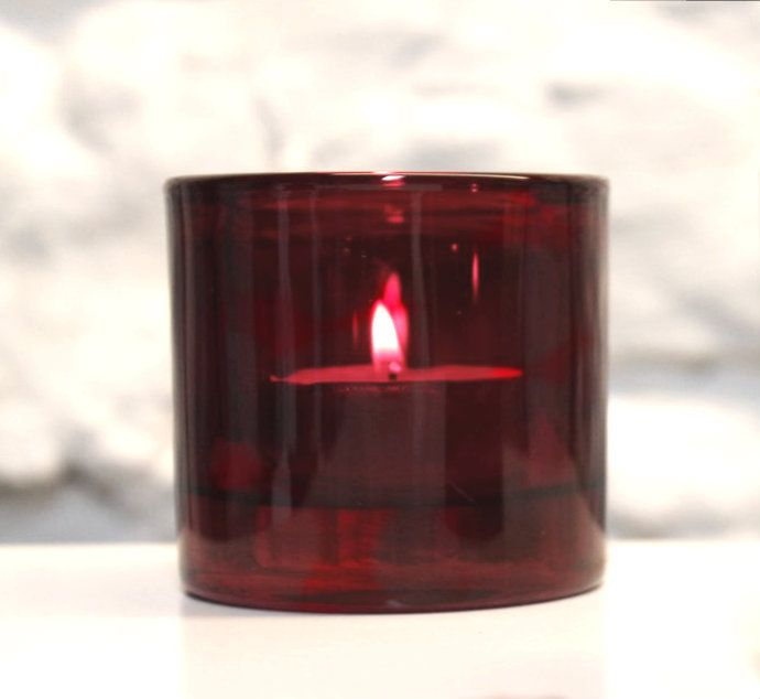 A festive red votive holder.