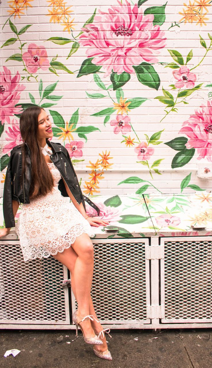 ad52aa1329d Style and travel blogger from NYC Eva Phan of Eva Darling sitting in white  Self Portrait lace fit and flare high neck dress with black leather  motorcycle ...