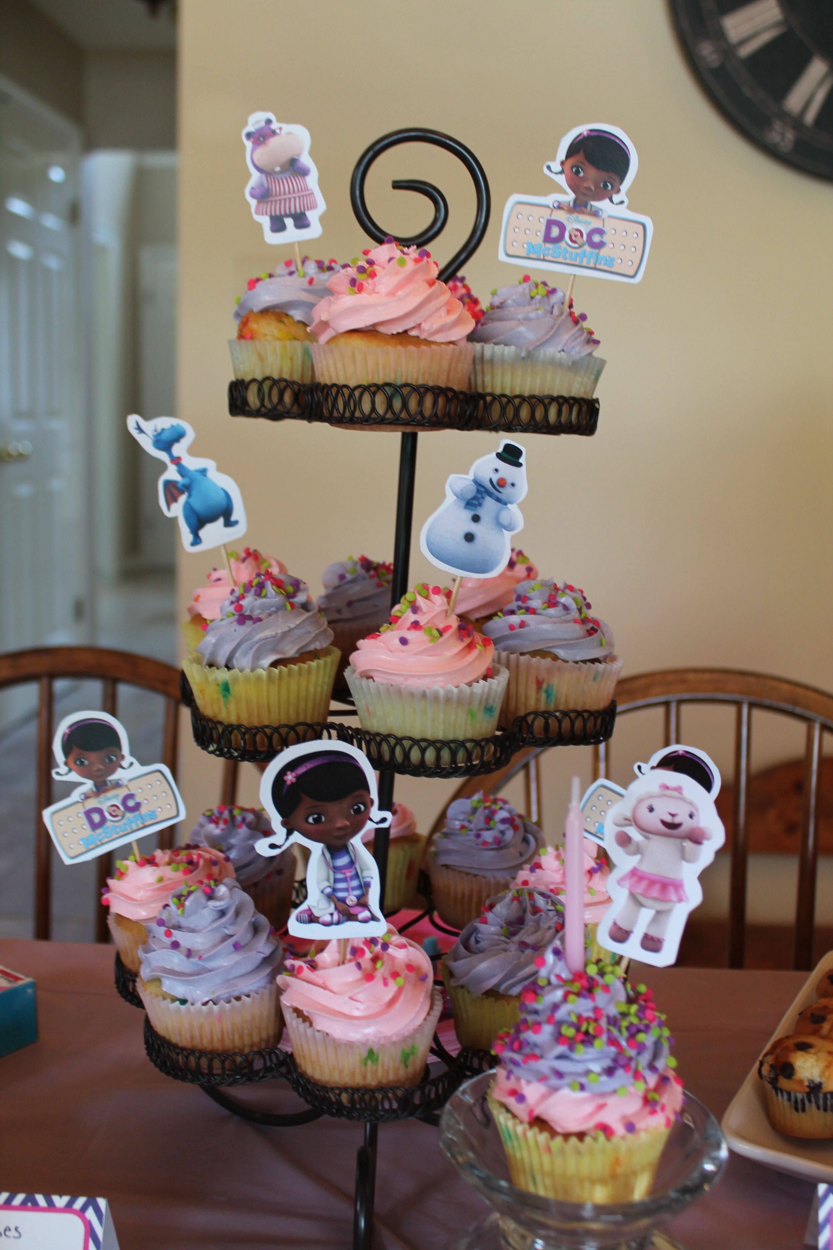 Doc mcstuffins bandages doc mcstuffins party ideas on pinterest doc - Doc Mcstuffins Cupcakes In Pink And Purple Frosting With Toppers